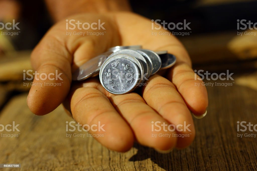 Indian coins in hand stock photo