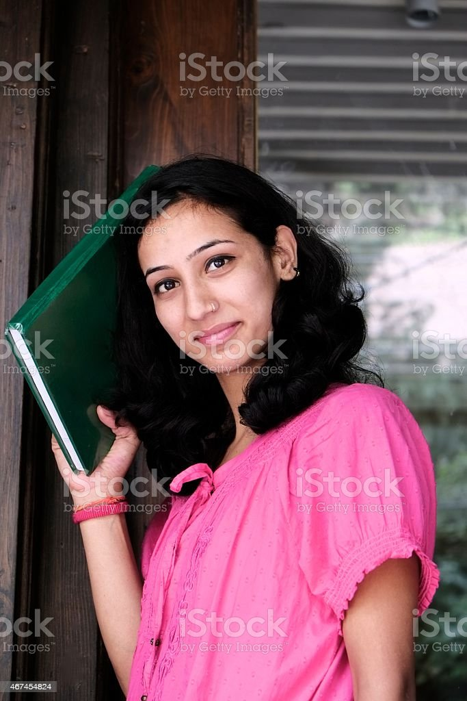 Indian college student outside the door. stock photo