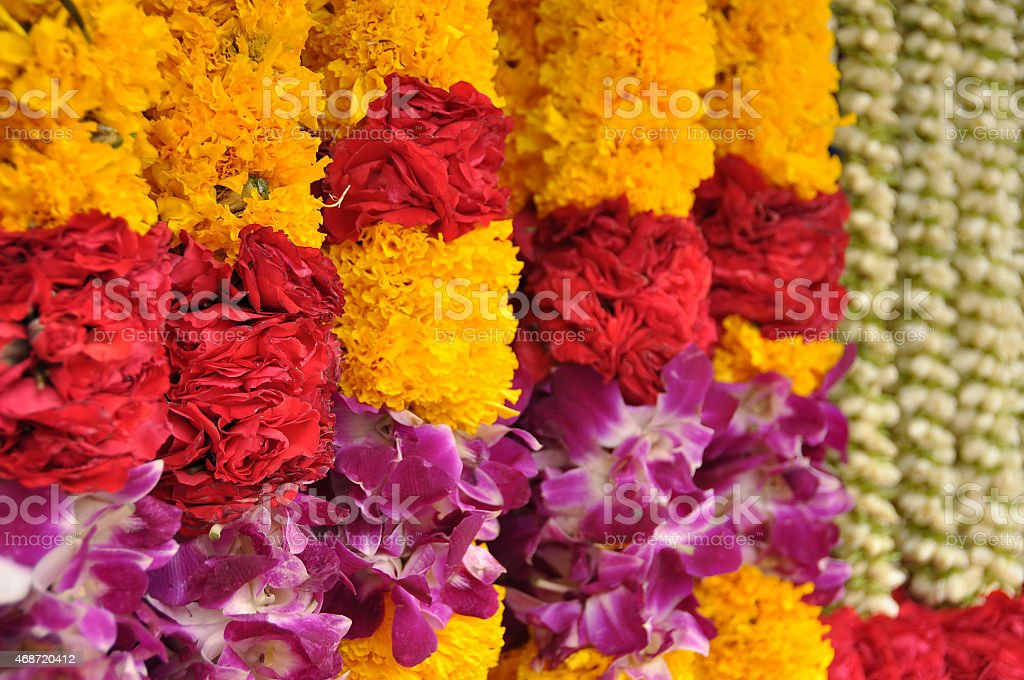 Indian colorful flower garlands in an hindu temple stock photo