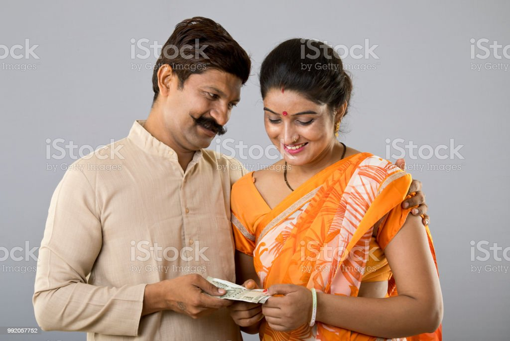 Indian couple holding money stock photo