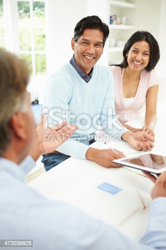 istock Indian Couple Meeting With Financial Advisor At Home 472039525