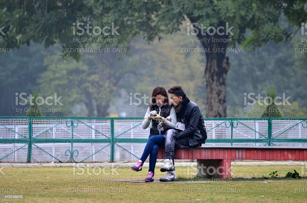 Indian couple visit Zakir Hussain Rose Garden in Chandigarh, India. stock photo