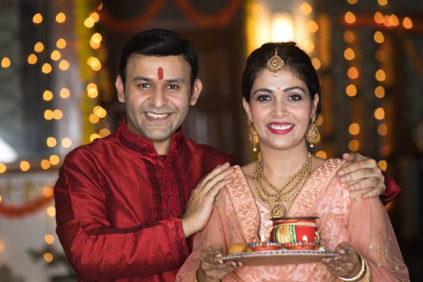 Indian couple with a plate of religious offering stock photo