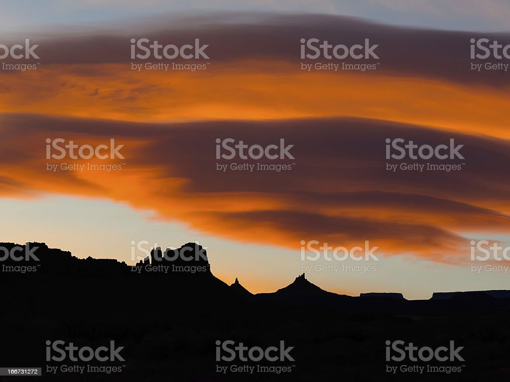 Indian Creek Western Landscape With Dramatic Sunset Clouds stock photo