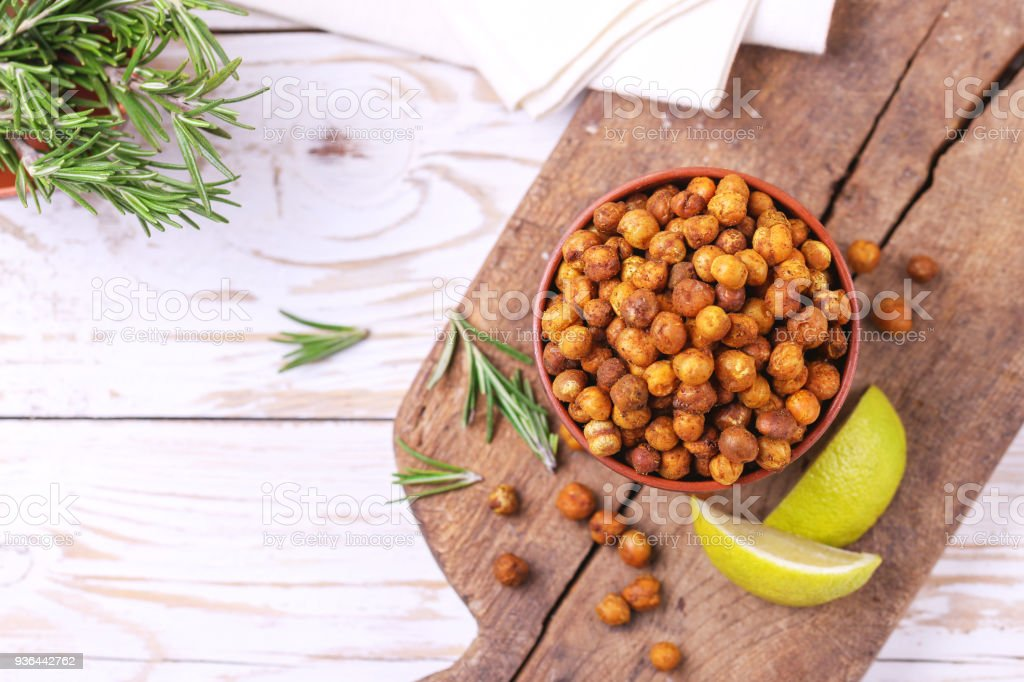Indian cuisine. Roasted chickpeas with lime and rosemary stock photo