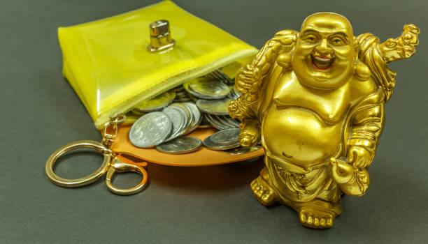 indischer währung münzen - buddha figuren kaufen stock-fotos und bilder