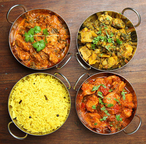 Indian Curries and Rice Food Indian chicken and vegetable curries with pilau rice. balti dish stock pictures, royalty-free photos & images