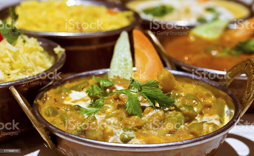 Indian curry and rice selection in copper balti dishes stock photo