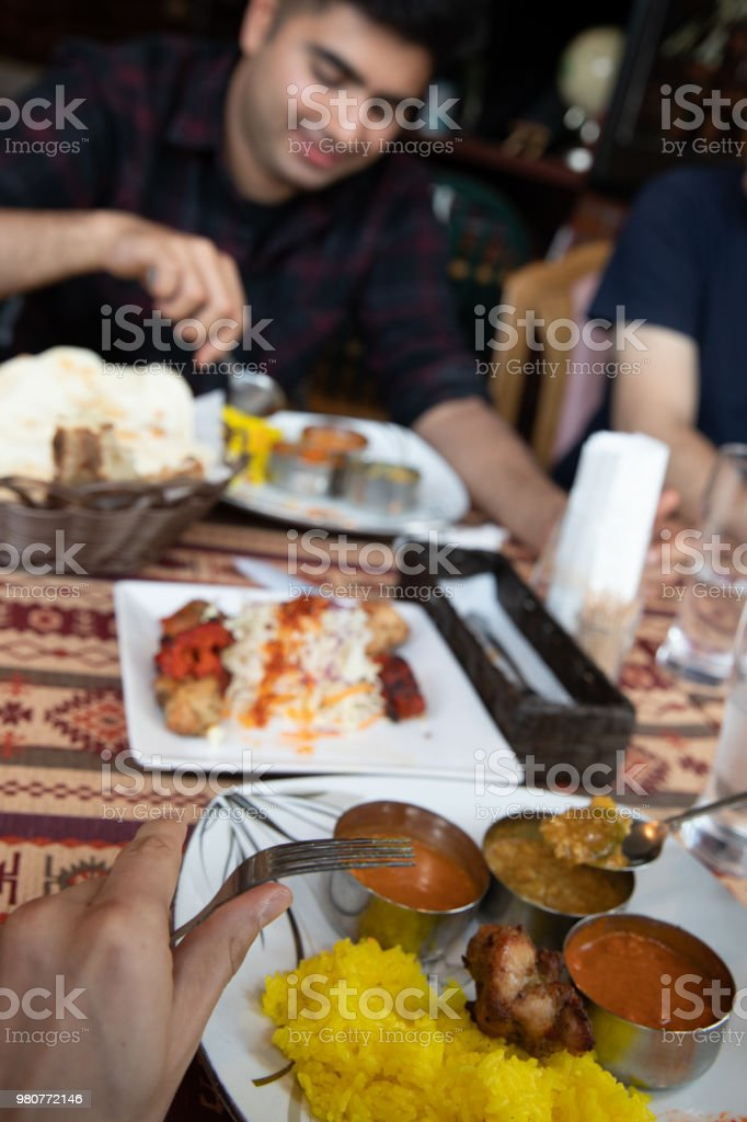 Indian curry buffet lunch with friends stock photo