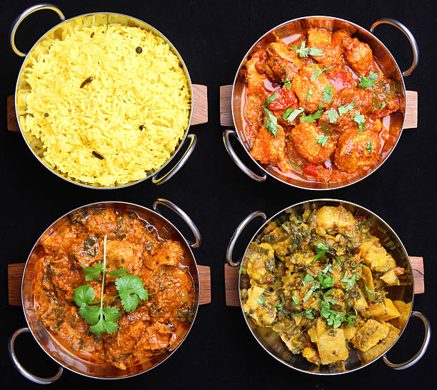 Indian Curry Food Selection Selection of Indian chicken and vegetable curries with rice. balti dish stock pictures, royalty-free photos & images