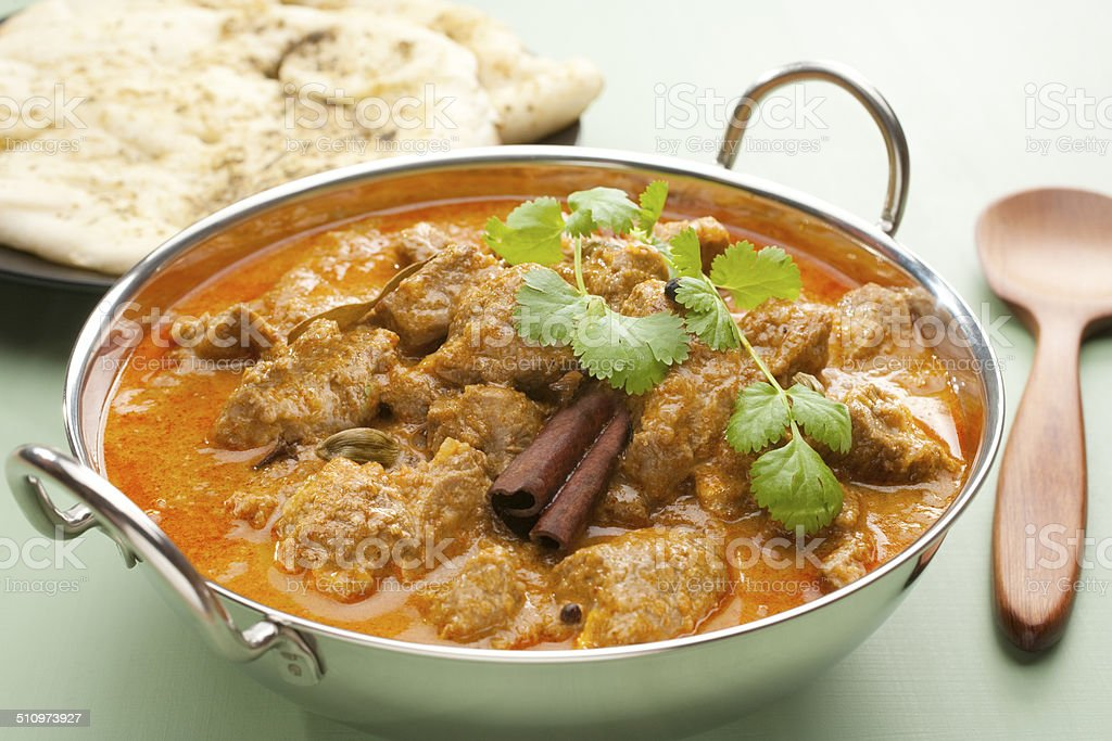 Indian Curry Lamb Rogan Josh Naan Bread stock photo