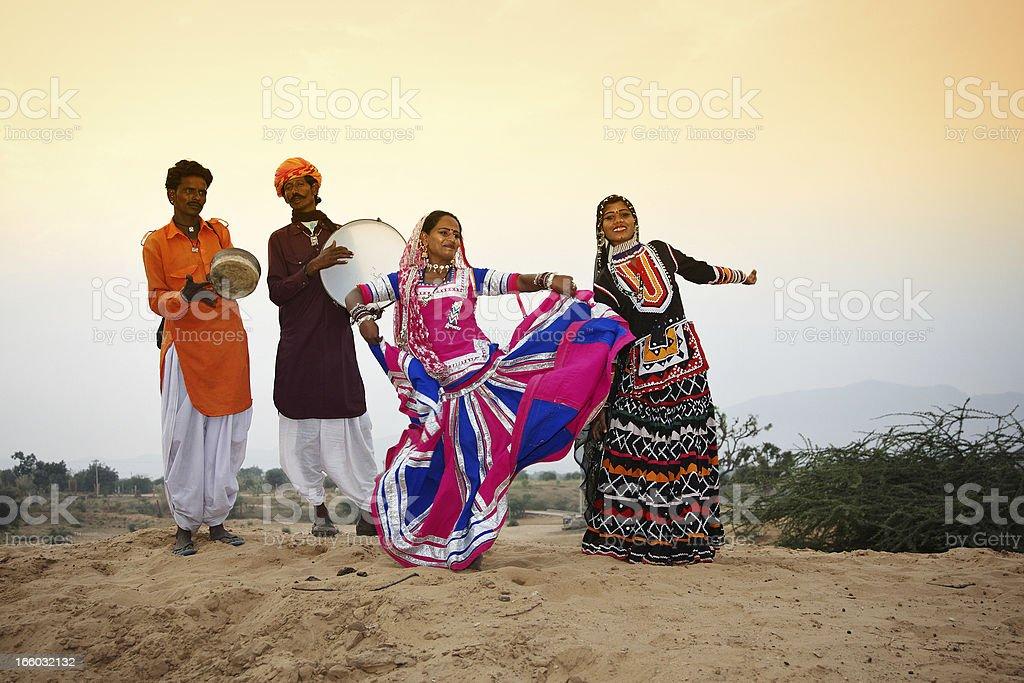 Indian dance troupe in Pushkar desert stock photo