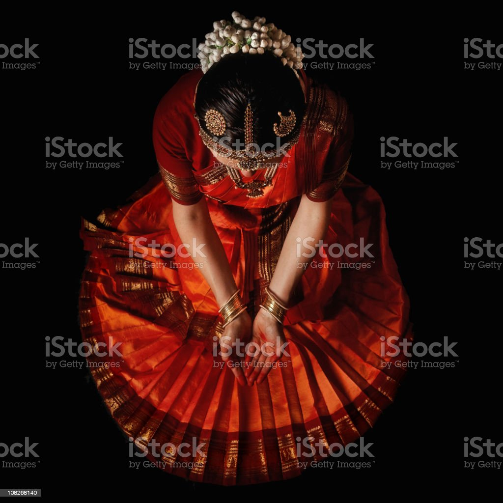 Indian dancer praying before the holy dance stock photo