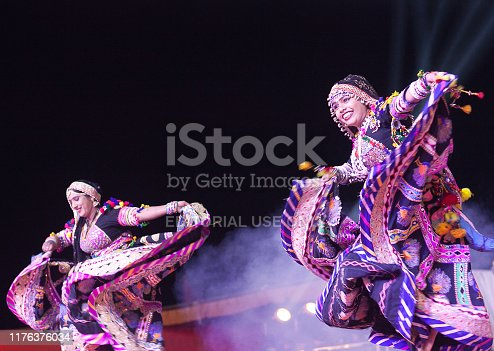 Bikaner, Rajasthan state, India - January 13, 2019: Indian women performing folk dance called Kalbeliya on Camel festival. Kalbelia is the one of the most sensuous dance forms of Rajasthan, performed by the Kalbelia tribe.