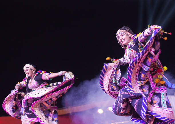 Indian dancers on Camel festival in Rajasthan state, India stock photo