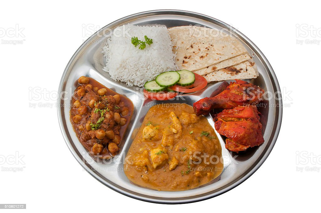 Indian dish thali with curry and tandoori chicken stock photo
