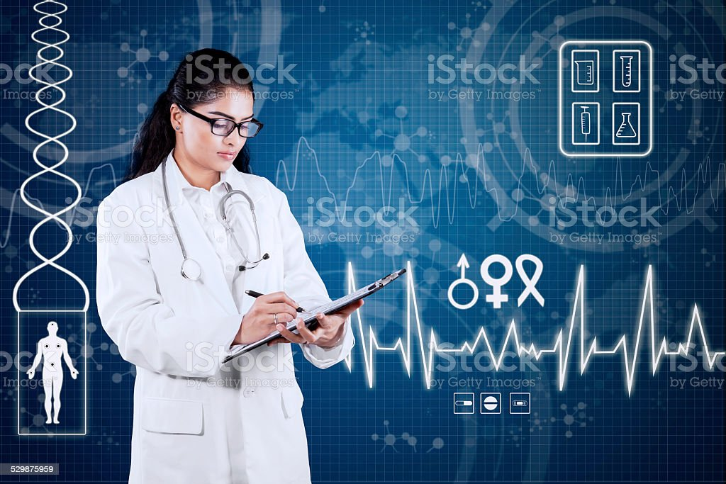 Indian doctor with medical background stock photo