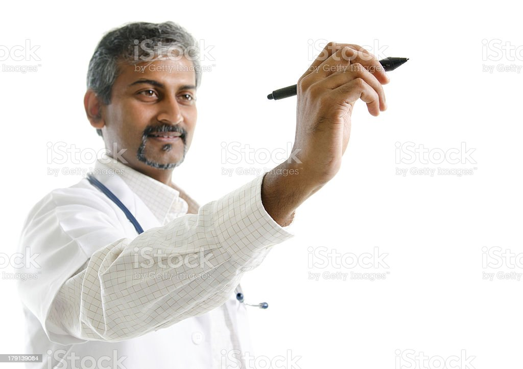 Indian doctor writing. stock photo