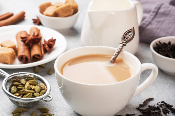 Indian drink masala tea with milk and spices. Cardamom sticks cinnamon star anise cane sugar. Indian drink masala tea with milk and spices. Cardamom sticks cinnamon star anise cane sugar allspice stock pictures, royalty-free photos & images