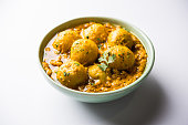 Indian Dum aloo curry using fried potatoes and spices, served in a bowl. selective focus