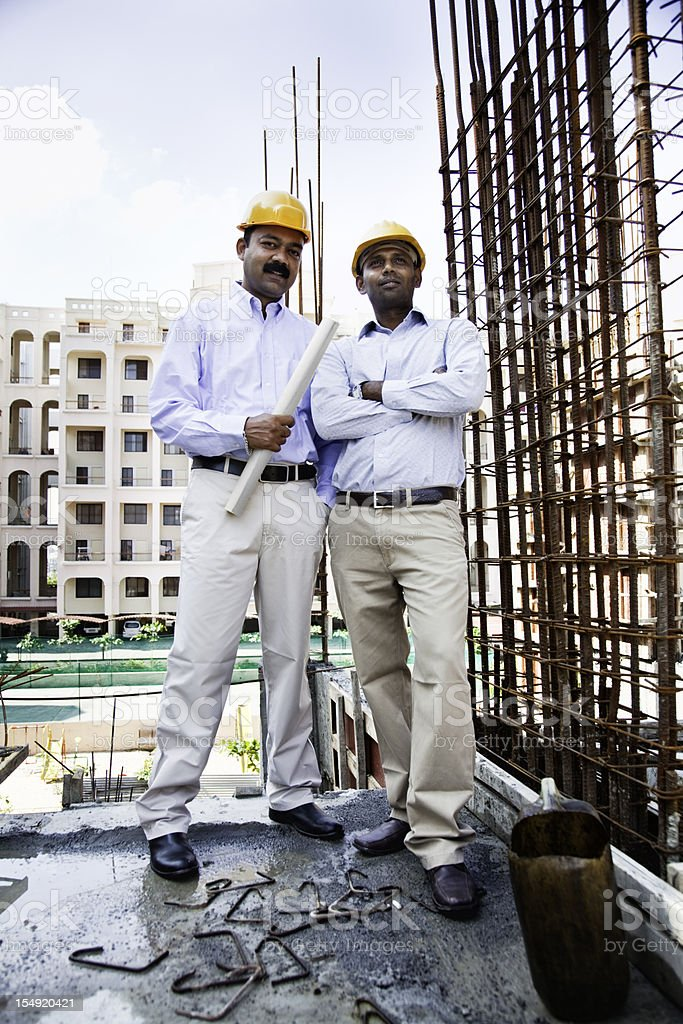 indian engineer architect on construction site stock photo