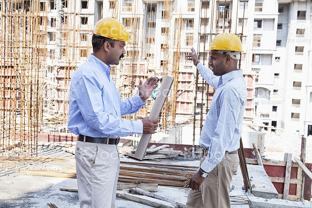 indian engineer architect on construction site royalty-free stock photo
