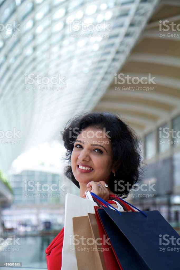 Indian ethnicity woman shopping in mall.