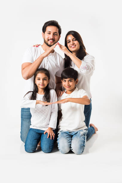 Indian Family and Home or real estate concept Indian family making the home sign over white background. selective focus indian family stock pictures, royalty-free photos & images