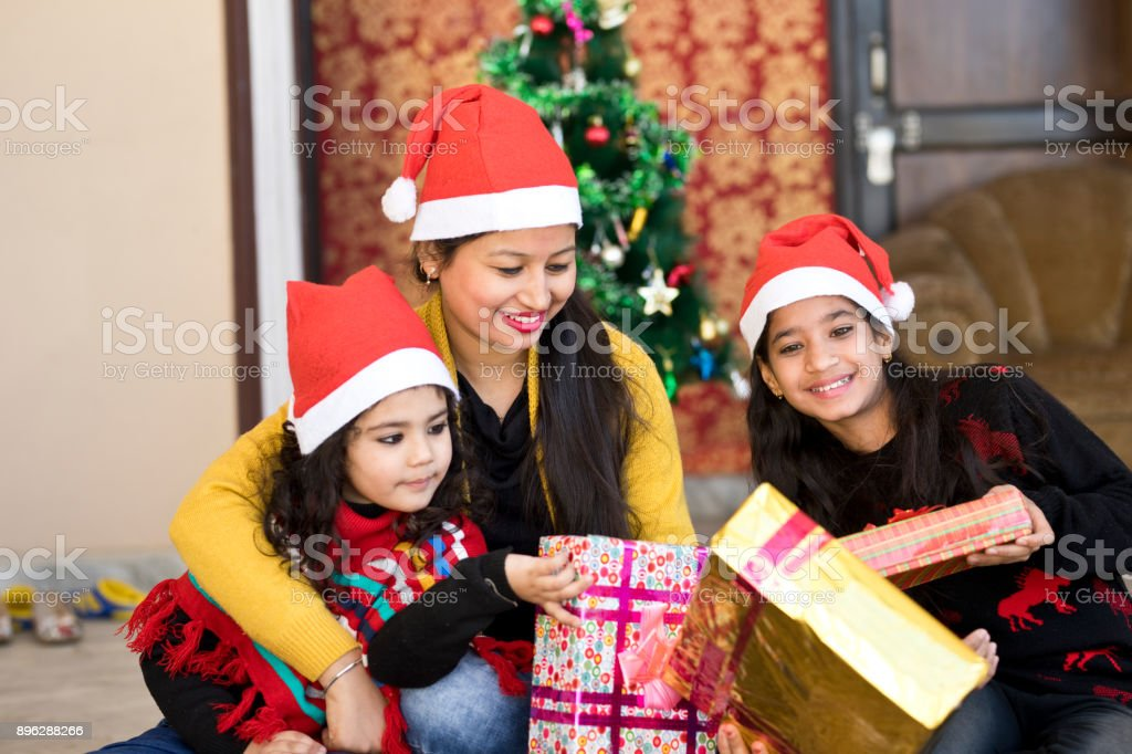 indian family celebrating christmas at home royalty free stock photo