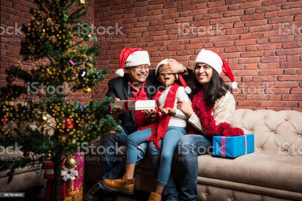 indian family celebrating christmas royalty free stock photo