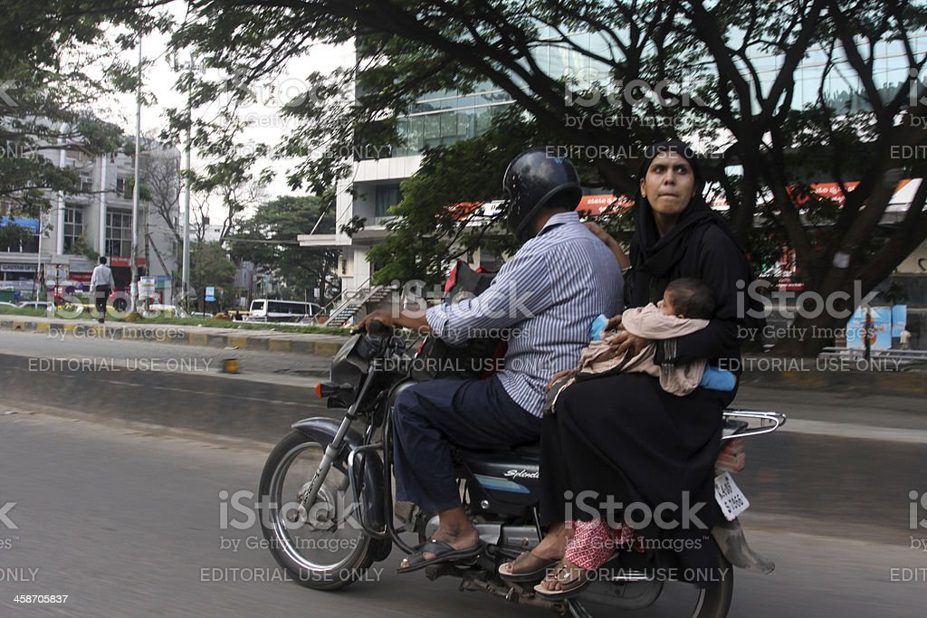 Indian family driving on motorcycle royalty-free stock photo