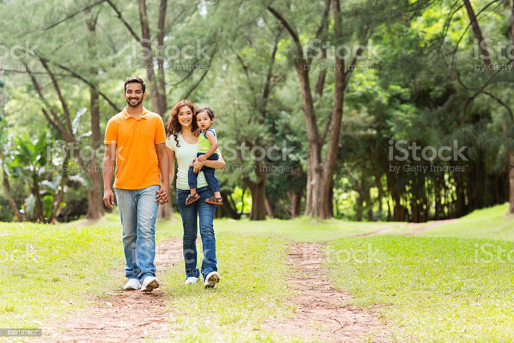 indian family going for a walk in forest stock photo