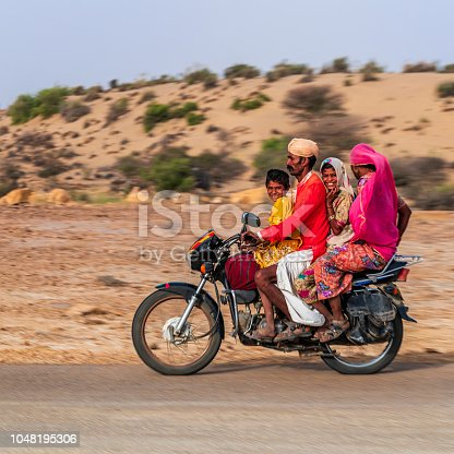 Indian family of 4 on a motorcycle, Rajasthan, India.