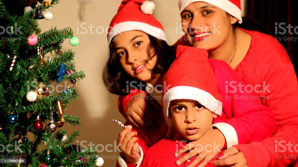 Christmas Festival In India.Indian Family Portrait Together During Christmas Festival