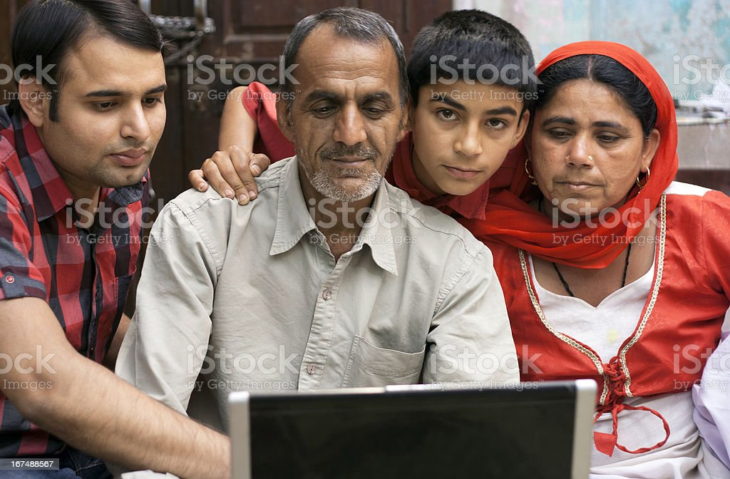 Indian Family Using Laptop at Home. royalty-free stock photo