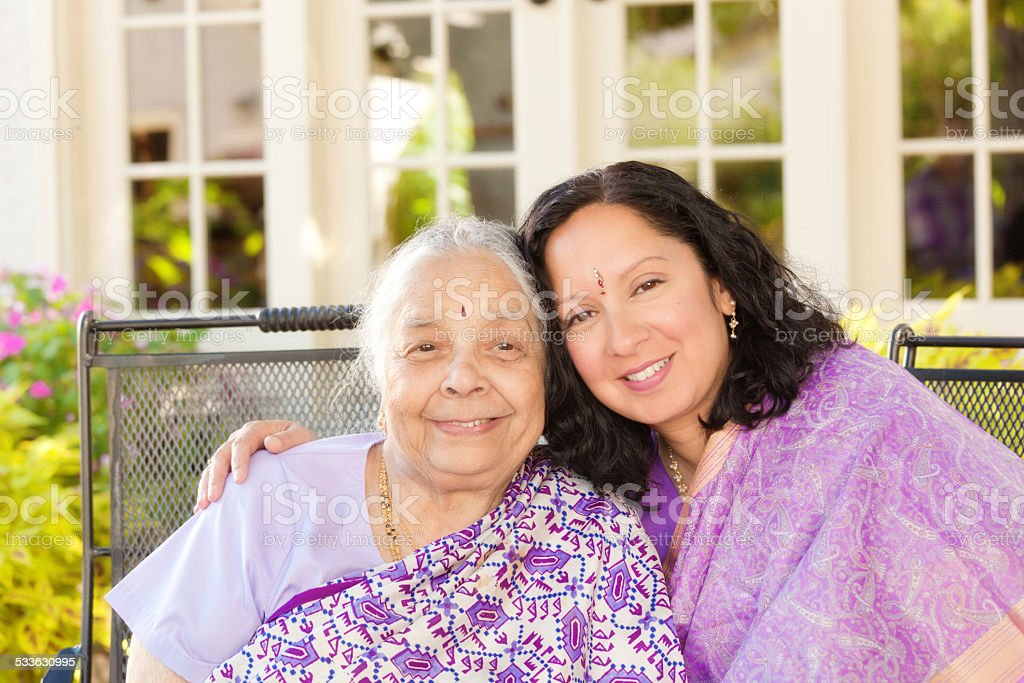 Indian Family—Mother and Daughter in Sari Dress Horizontal stock photo