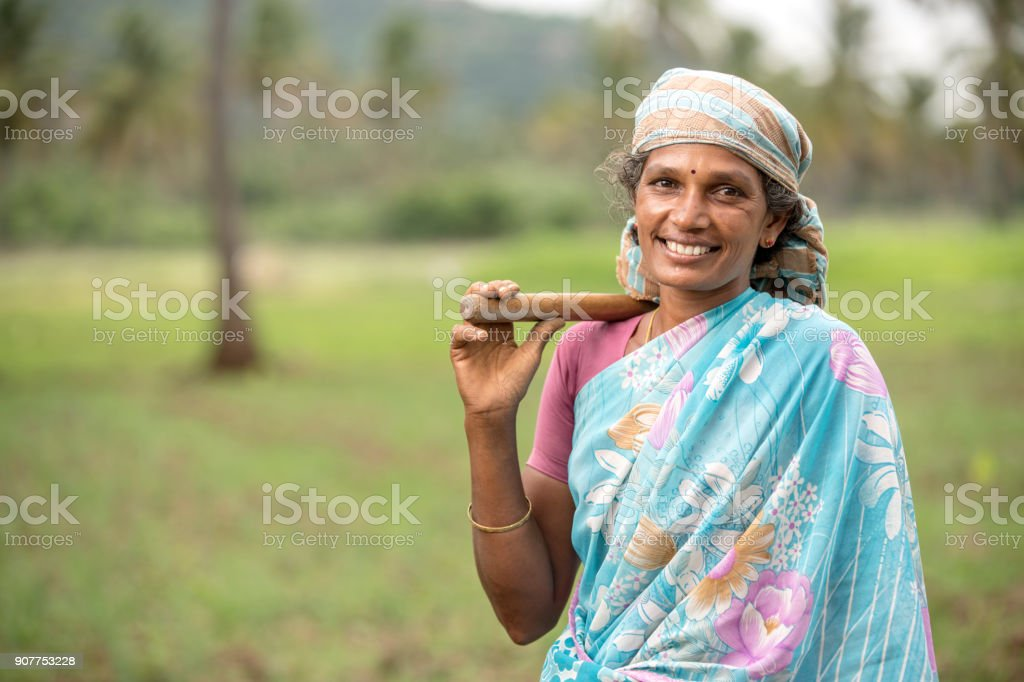 Indian farmer women on farm field with happy face stock photo