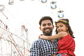 Indian father with daughter at amusement park