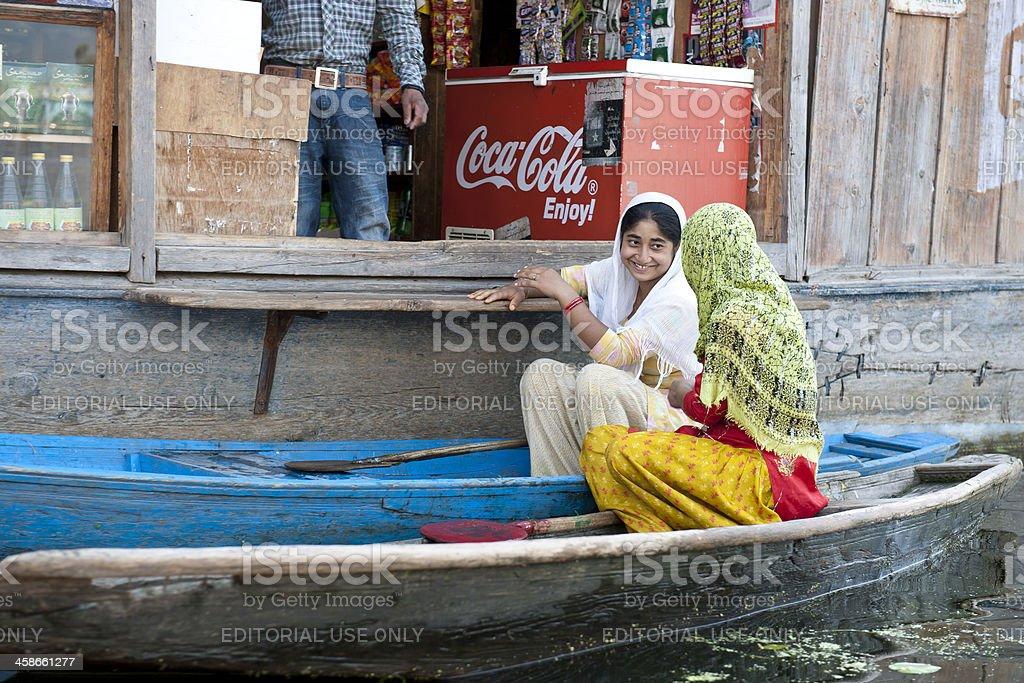 Indian Female Friends Talking in Boats Lake Dal Srinagar royalty-free stock photo
