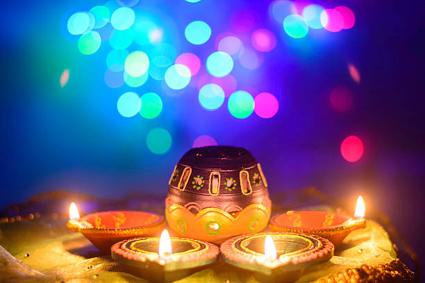 indian festival diwali oil lamp decoration - diwali stock pictures, royalty-free photos & images