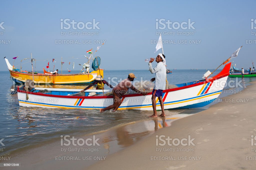 Indian Fishermen Catching Fish For Food In Wooden Boats Royalty Free Stock Photo