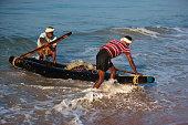 Indian fishermen on the sea, Kerala, India.http://bem.2be.pl/IS/tea_plantations_380.jpg