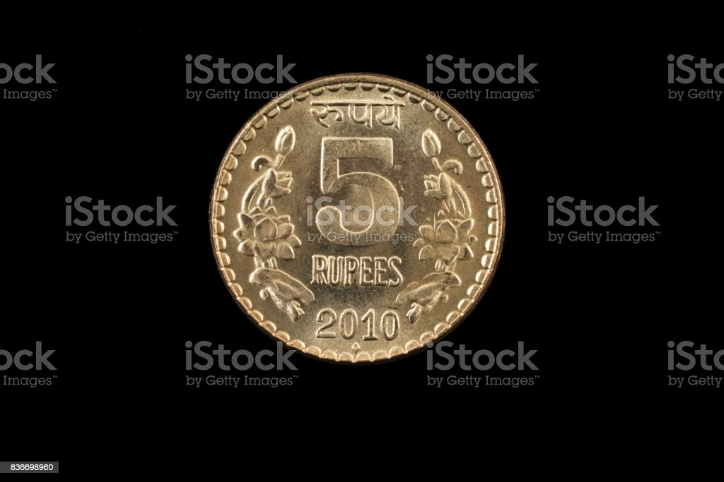 Indian five rupee coin close up on black stock photo
