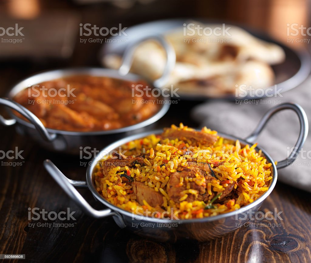 indian food - chicken biryani in balti dish stock photo