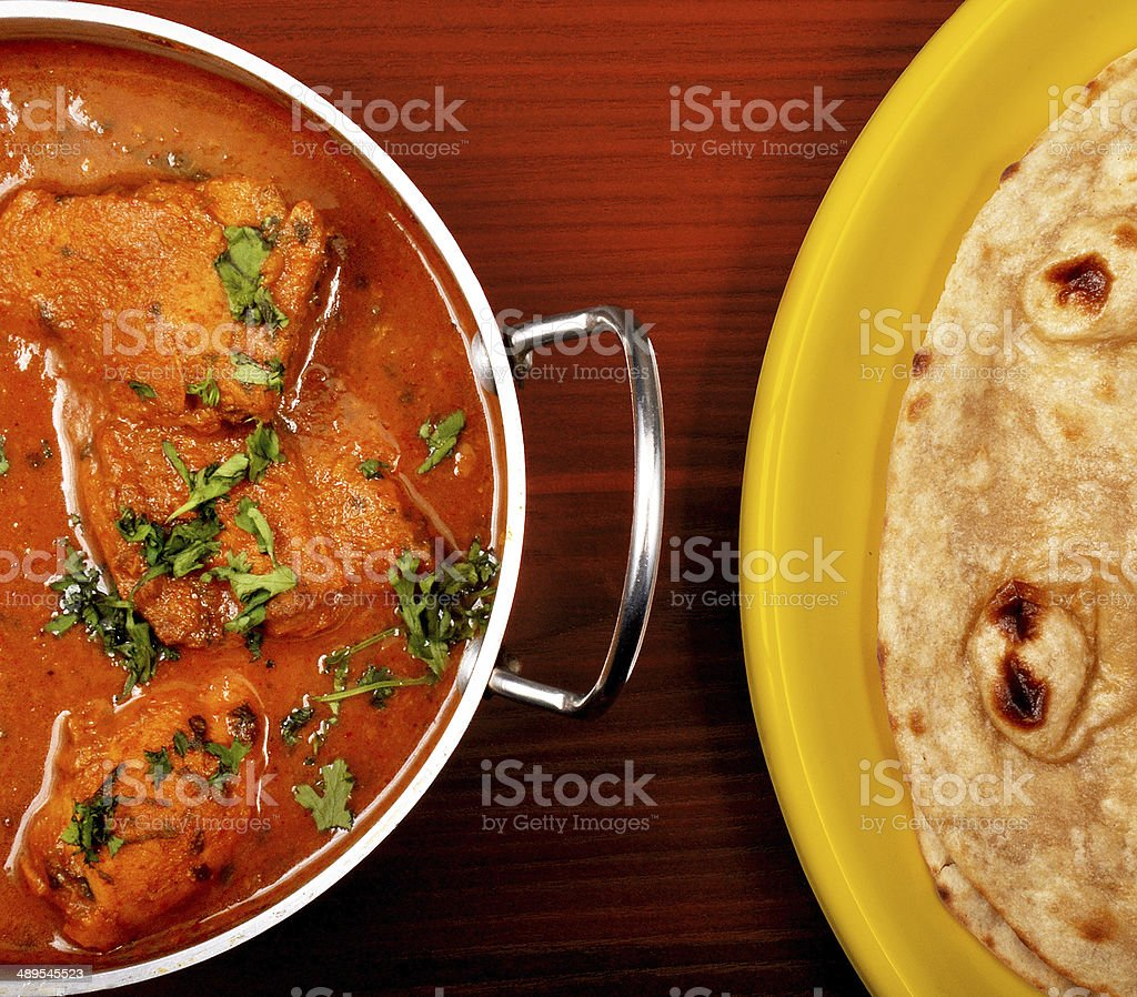 Indian food - Chicken handi and roti stock photo