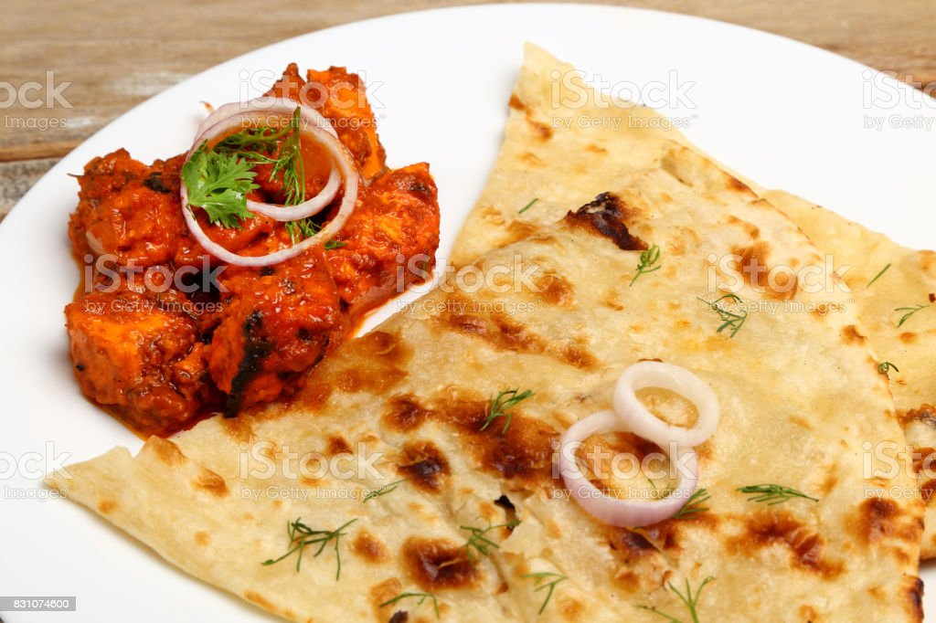 Indian Food in a ceramic plate with bread or roti. stock photo