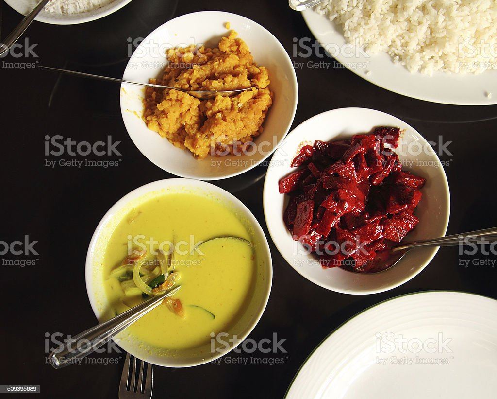 indian food in bowls on table stock photo
