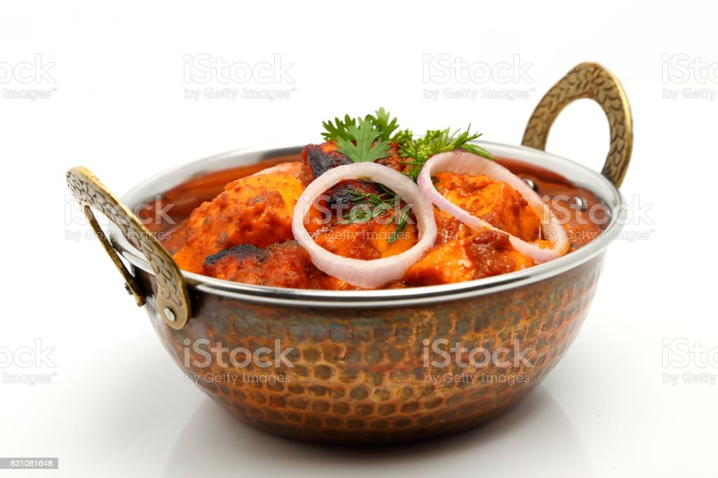 Indian Food or Indian Curry in a copper brass serving bowl. stock photo