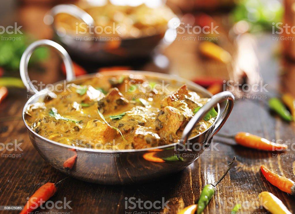 indian food - saag paneer curry dish indian saag paneer curry dish in balti dish, shot with selective focus Balti Dish Stock Photo