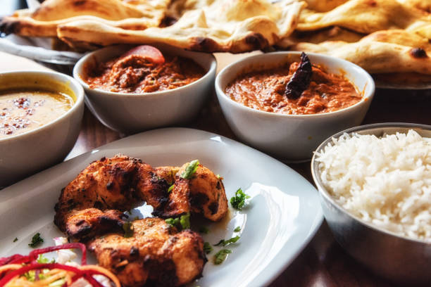 Indian Food Selection Table filled with freshly made Indian food balti dish stock pictures, royalty-free photos & images